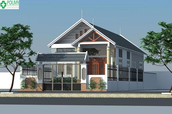 Màu mái xám tối đồng điệu với màu cổng tạo nên vẻ đẹp sang trọng cho ngôi nhà