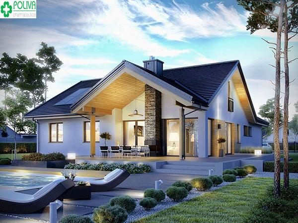 Màu mái xám kết hợp với ánh đèn lung linh buổi đêm tăng nét huyền ảo cho ngôi nhà