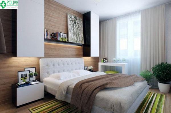 """Không nên kê giường sát vào tường, hãy lấp đầy khoảng trống bằng cách """"nhét"""" thêm tủ hoặc treo ảnh..."""