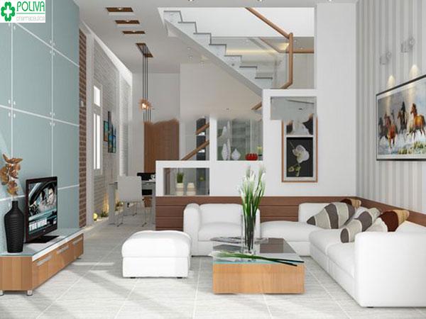 Cách bố trí cầu thang lên tầng khá hài hòa với không gian của phòng khách