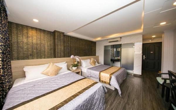 Phong cách hiện đại với gam màu trầm của khách sạn Happy Inn