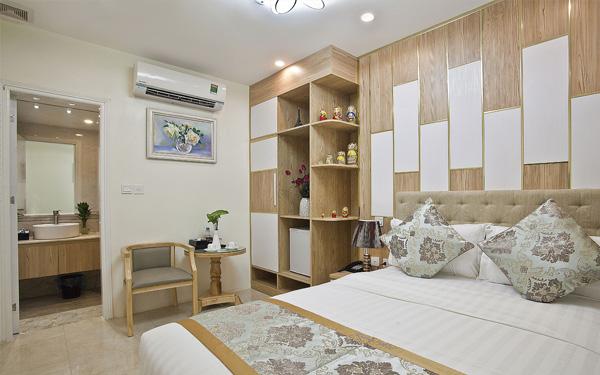 Nội thất phòng ngủ hài hòa của khách sạn DLmos Hà Nội