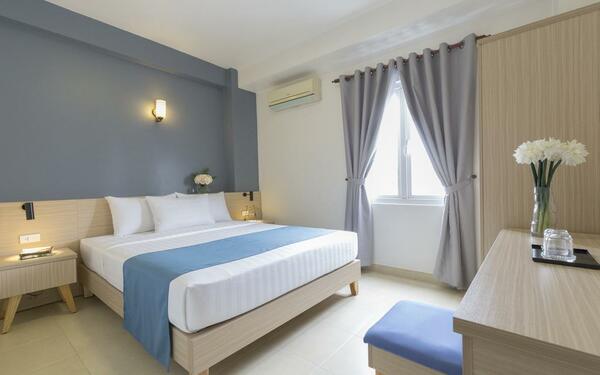 Các tông màu nhã nhặn kết hợp hài hòa trong không gian phòng ngủ