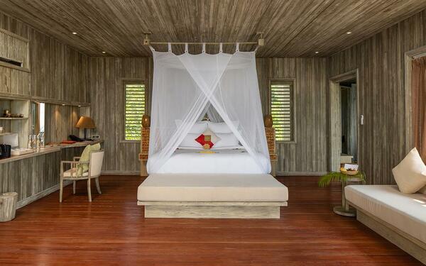 Chất liệu gỗ mộc mạc tạo nên không gian ấm cúng của phòng nghỉ tại An Lâm Restreat Ninh Vân Bay