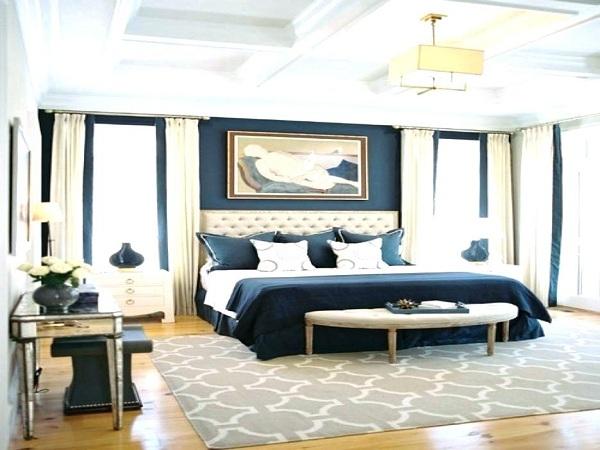 Tấm thảm trải sàn với họa tiết lớn sẽ giúp căn phòng bớt trống trải